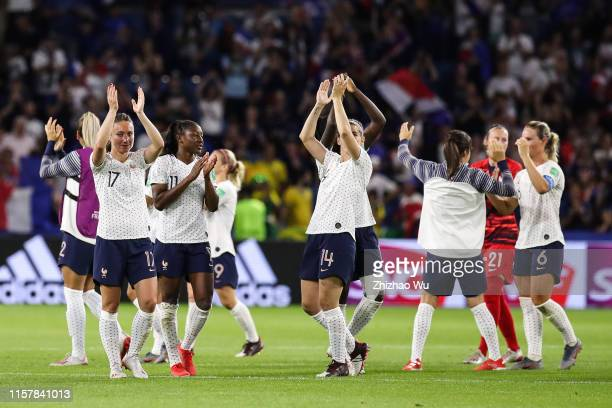 Players of France celebrate the victory with fans after the 2019 FIFA Women's World Cup France Round Of 16 match between France and Brazil at Stade...