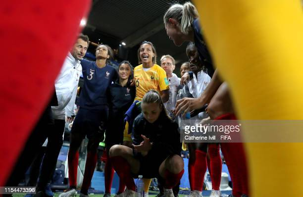 Players of France celebrate together following the 2019 FIFA Women's World Cup France group A match between France and Korea Republic at Parc des...