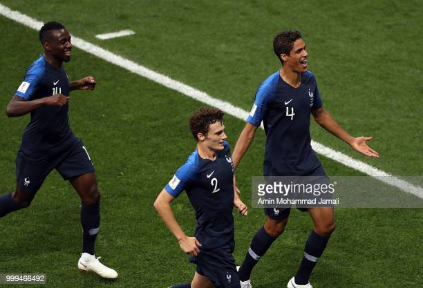 players of france celebrate with teammates after his freekick leads to an own goal by Mario Mandzukic of Croatia and France's first goalduring the...
