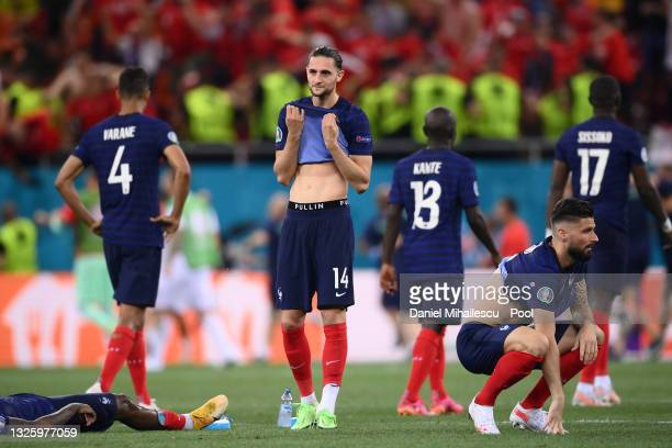 Players of France look dejected after team mate Kylian Mbappe misses their side's decisive penalty during the UEFA Euro 2020 Championship Round of 16...