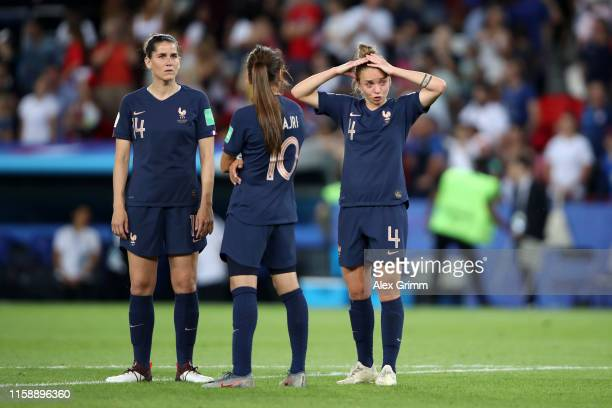 Players of France look dejected following the 2019 FIFA Women's World Cup France Quarter Final match between France and USA at Parc des Princes on...