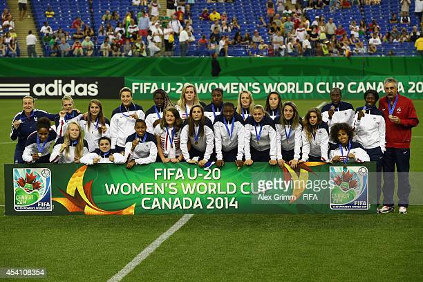 Players of France pose after finishing third in the FIFA U20 Women's World Cup Canada 2014 at Olympic Stadium on August 24 2014 in Montreal Canada