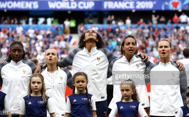 Players of France sing the national anthem prior to the 2019 FIFA Women's World Cup France Round Of 16 match between France and Brazil at Stade...