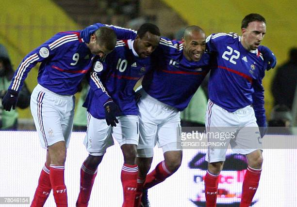 Players of France's national team react after they scored during their Euro 2008 qualifying football match Ukraine vs France 21 November 2007 at the...