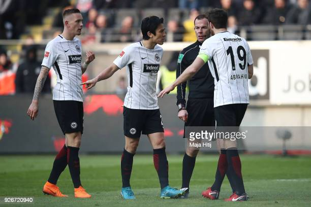Players of Frankfurt argue with referee Marco Fritz following a penalty decision during the Bundesliga match between Eintracht Frankfurt and Hannover...