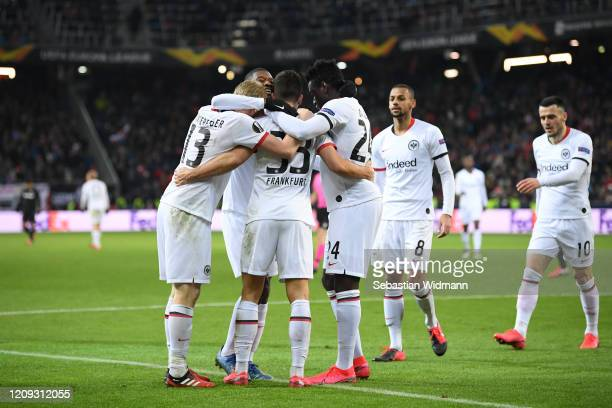 Players of Frankfurt celebrate their second goal during the UEFA Europa League round of 16 second leg match between RB Salzburg and Eintracht...