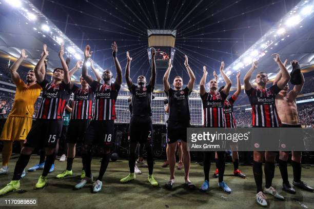 Players of Frankfurt celebrate with the fans after the second leg of the UEFA Europa League playoff match between Eintracht Frankfurt and Racing Club...