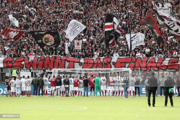 Players of Frankfurt stand in front of their fans after the Bundesliga match between Eintracht Frankfurt and RB Leipzig at CommerzbankArena on May 20...