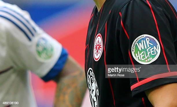 Players of Frankfurt wear the 'Wir Helfen' badge on the shirt during the Bundesliga match between Hamburger SV and Eintracht Frankfurt at...