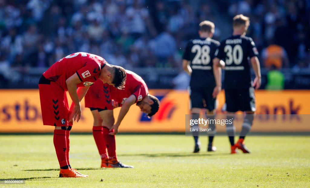 Players of Freiburg are looking dejected after the Bundesliga match between Borussia Moenchengladbach and Sport-Club Freiburg at Borussia-Park on May 5, 2018 in Moenchengladbach, Germany.