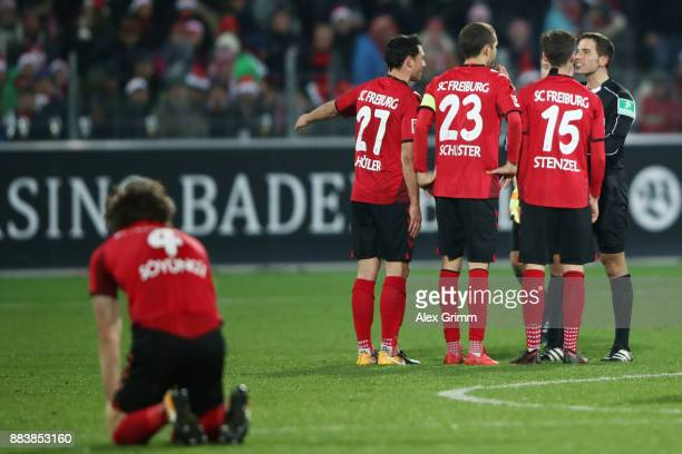 Players of Freiburg discuss with referee Benjamin Brand after the Bundesliga match between SportClub Freiburg and Hamburger SV at SchwarzwaldStadion...