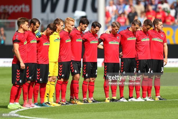Players of Freiburg observe a minute's silence in memory of the victims of Thursday's terrorist attacks in Spain during the Bundesliga match between...