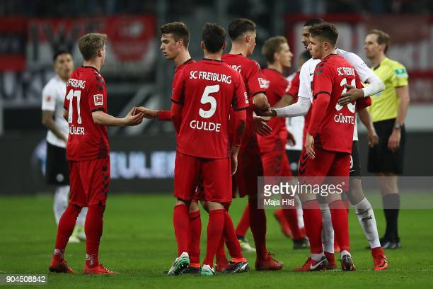 Players of Freiburg stand together after the Bundesliga match between Eintracht Frankfurt and SportClub Freiburg at CommerzbankArena on January 13...
