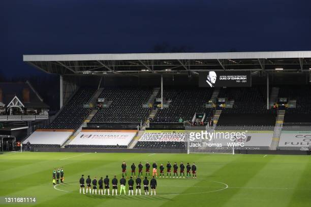 Players of Fulham and Wolverhampton Wanderers participate in two minutes' silence to honor Prince Philip, Duke of Edinburgh prior to the Premier...
