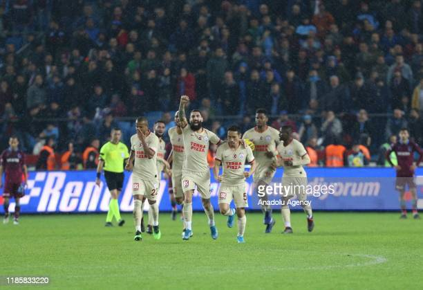 Players of Galatasaray celebrate after Nagatomo scored a goal during the Turkish Super Lig week 13 soccer match between Trabzonspor and Galatasaray...