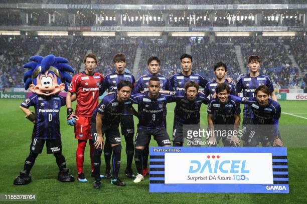 Players of Gamba Osaka line up for team photos prior to JLeague J1 match between Gamba Osaka and Vissel Kobe at Panasonic Stadium Suita on March 30...