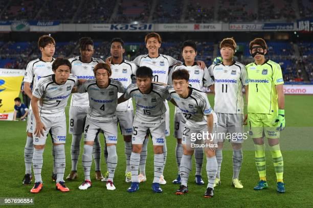 Players of Gamba Osaka line up for the team photos prior to the JLeague J1 match between Yokohama FMarinos and Gamba Osaka at Nissan Stadium on May...