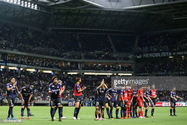 Players of Gamba Osaka thank the crowd after the J.League J1 match between Gamba Osaka and FC Tokyo at Suita City Football Stadium on August 10, 2018...