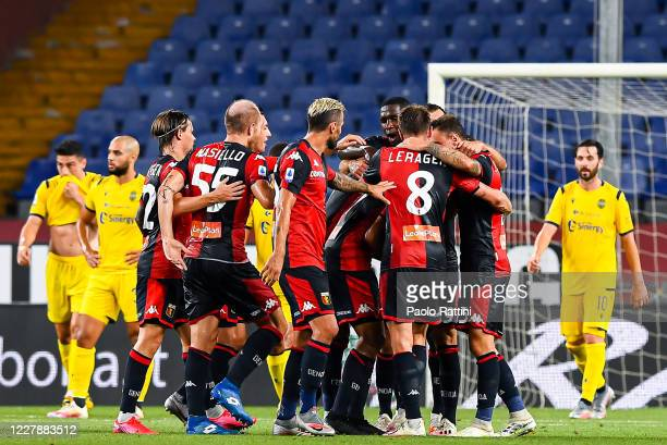 Players of Genoa celebrate after Cristian Romero of Genoa has scored a goal during the Serie A match between Genoa CFC and Hellas Verona at Stadio...
