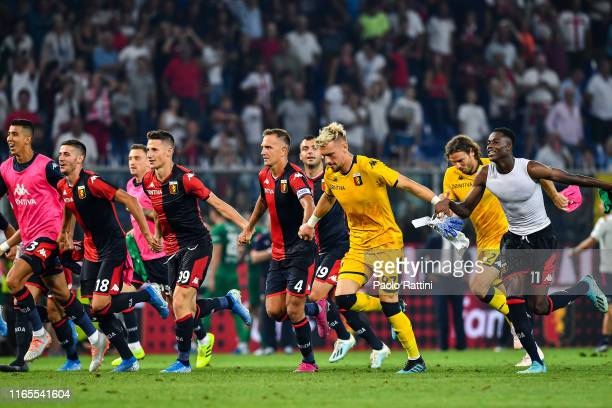Players of Genoa celebrate after the Serie A match between Genoa CFC and ACF Fiorentina at Stadio Luigi Ferraris on September 1 2019 in Genoa Italy
