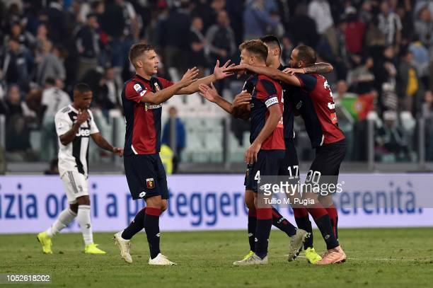 Players of Genoa celebrate after the Serie A match between Juventus and Genoa CFC at Allianz Stadium on October 20 2018 in Turin Italy