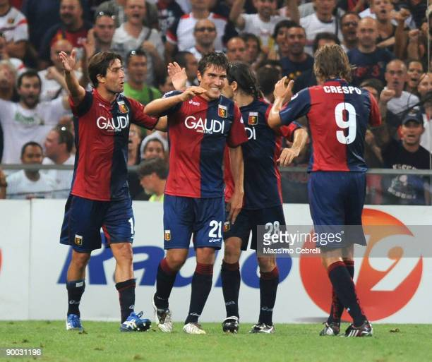 Players of Genoa CFC celebrate the third goal scored by Giuseppe Biava during the Serie A match between Genoa CFC and AS Roma at the Luigi Ferraris...