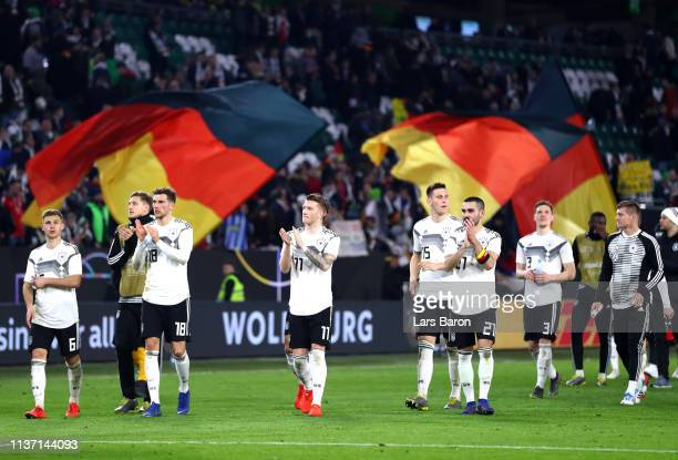Players of Germany acknowledges the fans following their draw in the International Friendly match between Germany and Serbia at Volkswagen Arena on...