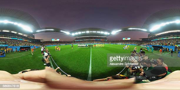 Players of Germany and Australia stand for the national anthems before the match between Germany and Australia Women's Football for the summer...