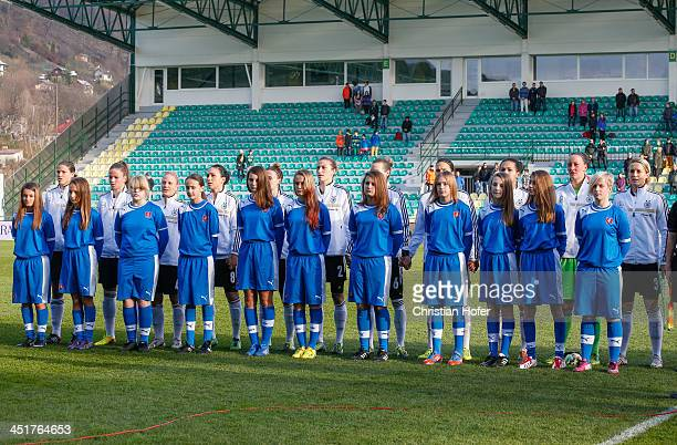 Players of Germany and ball girls line up for the national anthem prior to the FIFA Women's World Cup 2015 Qualifier between Slovakia and Germany at...
