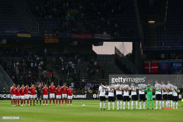 Players of Germany and Denmark observe a minute's silence for the victims of the London Bridge terrorist attack prior the international friendly...