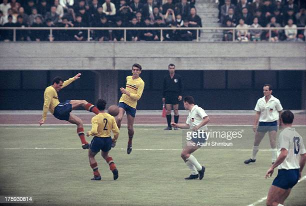 Players of Germany and Romania compete for the ball during the football Group A match between Germany and Romania at Komazawa Stadium on October 13...