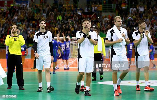 Players of Germany are looking dejected after loosing the Mens Preliminary Group B match between Brazil and Germany at Future Arena on August 11,...