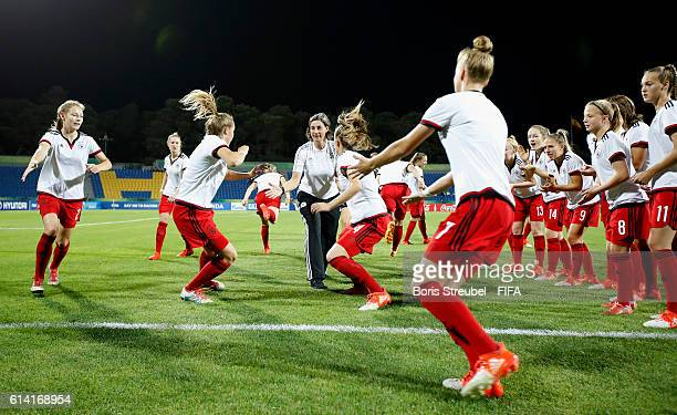 Players of Germany are pictured during warmup prior to the FIFA U17 Women's World Cup Quarter Final match between Germany and Spain at Amman...