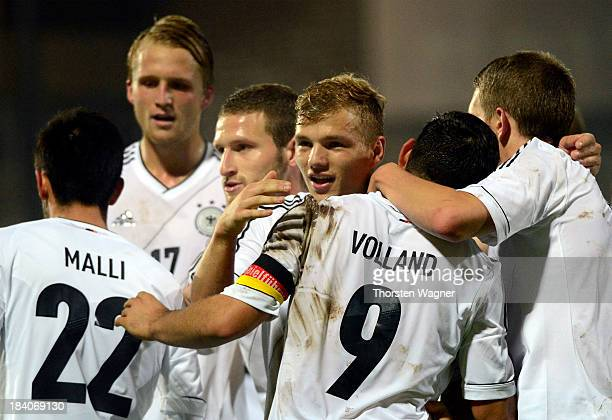 Players of Germany celebrate after Kevin Volland scored his team's second goal during the U21 Euro qualifier group 6 match between Germany and...
