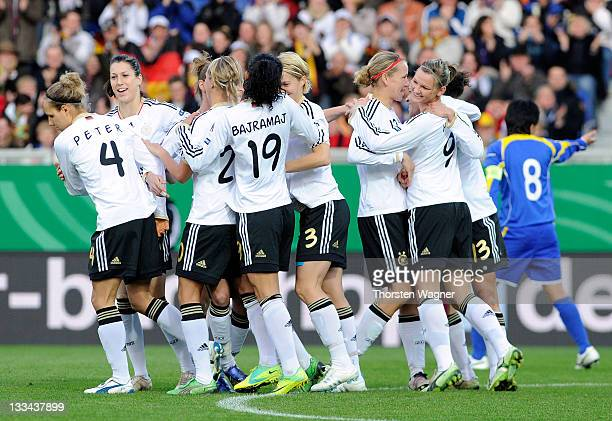 Players of Germany celebrate after scoring a goal during the Womens's Euro 2013 qualifier group 2 match between Germany and Kazakhstan at BRITAArena...