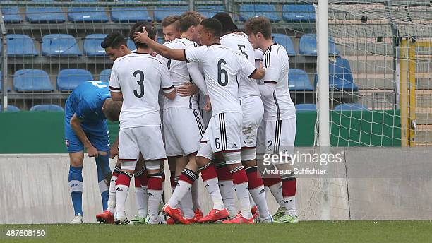 Players of Germany celebrate after scoring the first goal during the UEFA Under19 Elite Round match between U19 Germany and U19 Slovakia at...