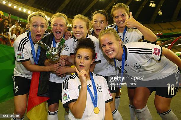 Players of Germany celebrate after winning the FIFA U-20 Women's World Cup Canada 2014 final match between Nigeria and Germany at Olympic Stadium on...