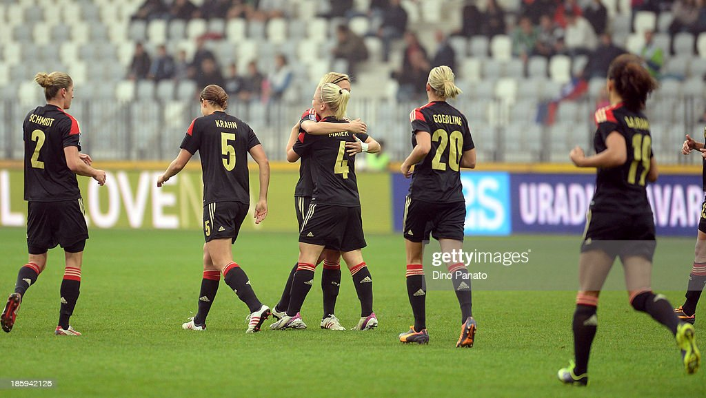 Players of Germany celebrate during the Qualifying Round - FIFA Women's World Cup between Slovenia and Germany at SRC Bonifika stadio on October 26, 2013 in Koper, Slovenia.