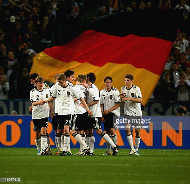 Players of Germany celebrate the first team goal during the international friendly match between Germany and Australia at BorussiaPark on March 29...