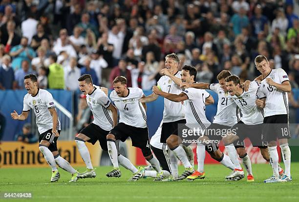 Players of Germany celebrate the victory following the UEFA Euro 2016 quarter final match between Germany and Italy at Stade de Bordeaux in Bordeaux...