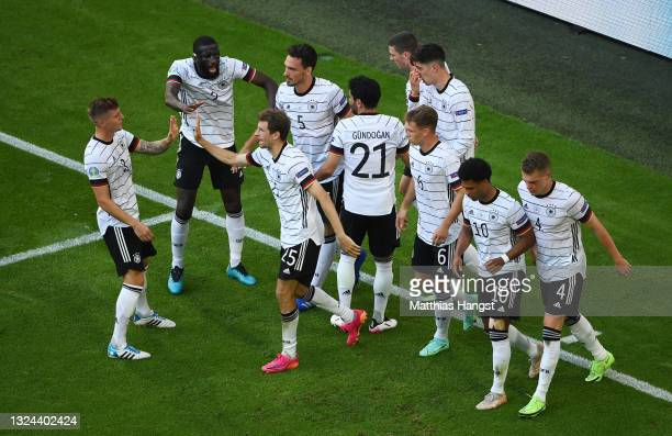Players of Germany celebrate their side's second goal, an own goal by Raphael Guerreiro of Portugal during the UEFA Euro 2020 Championship Group F...