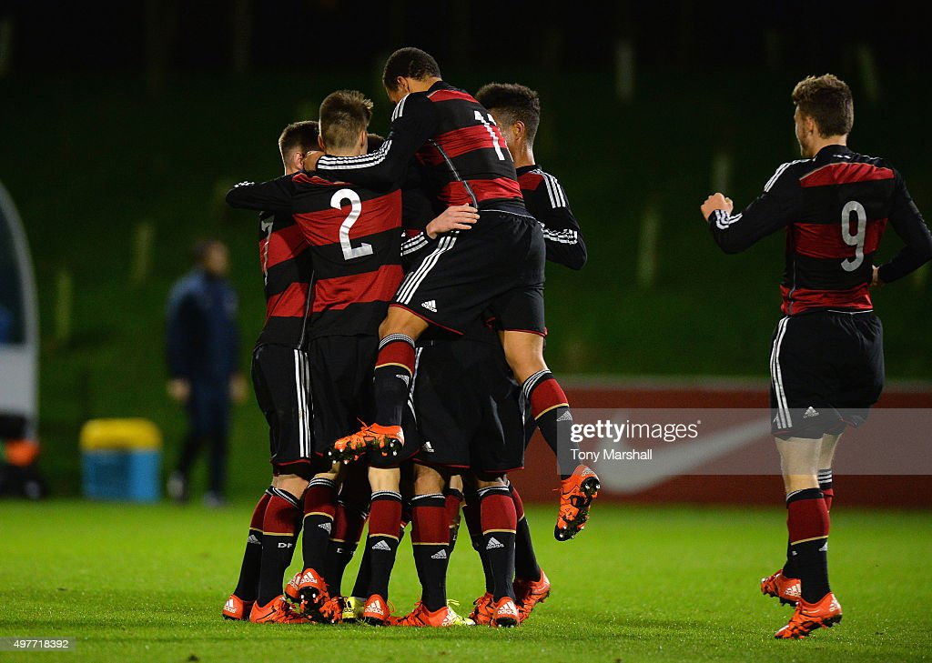 Players of Germany celebrate their third goal during the U17s International Friendly match between England U17 and Germany U17 at St Georges Park on November 18, 2015 in Burton-upon-Trent, England.