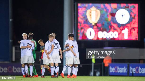 Players of Germany celebrate their win after the friendly match between Belgium U16 and Germany U16 on October 3 2017 in Genk Belgium