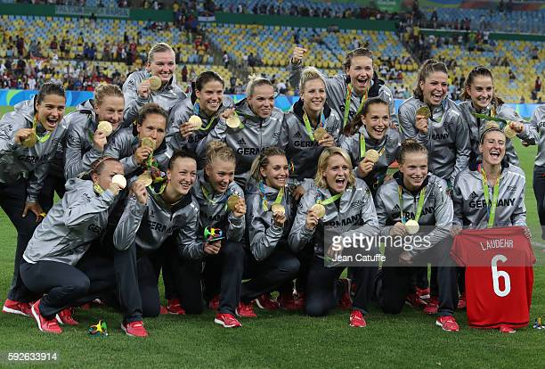 Players of Germany celebrate winning the gold medal during the medal ceremony following the Women's Soccer Final between Germany and Sweden at...