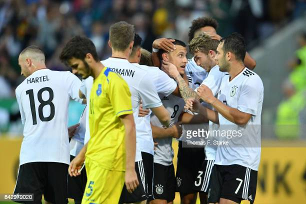 Players of Germany celebrate with Maximilian Eggestein during the UEFA Euro 2019 Qualifier match between Germany U21 and Kosovo U21 at Osnatel Arena...