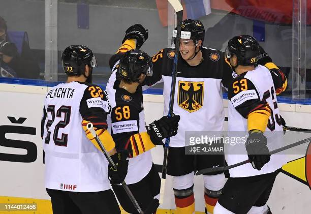 Players of Germany celebrates after scoring during the group A stage match Germany vs Slovakia of the 2019 IIHF Ice Hockey World Championship at...
