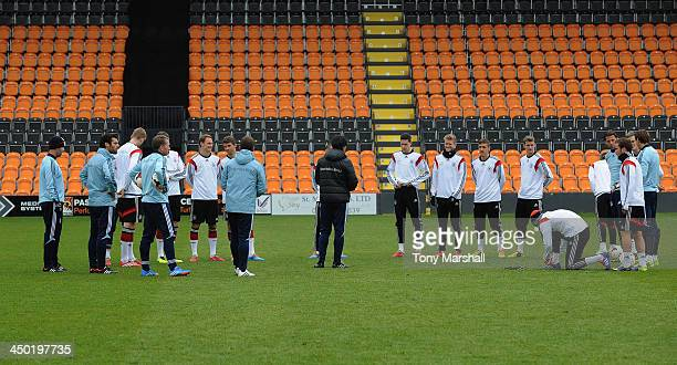 Players of Germany get instructions from Joachim Loew Head Coach of Germany during the Germany Training Session at The Hive on November 17 2013 in...