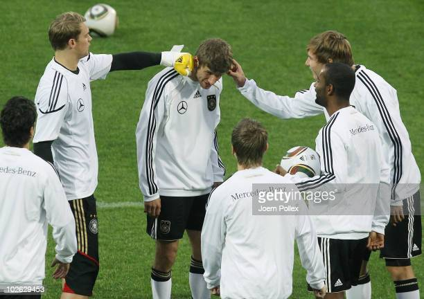 Players of Germany joke with Thomas Mueller during a training session at Super stadium on July 5 2010 in Pretoria South Africa