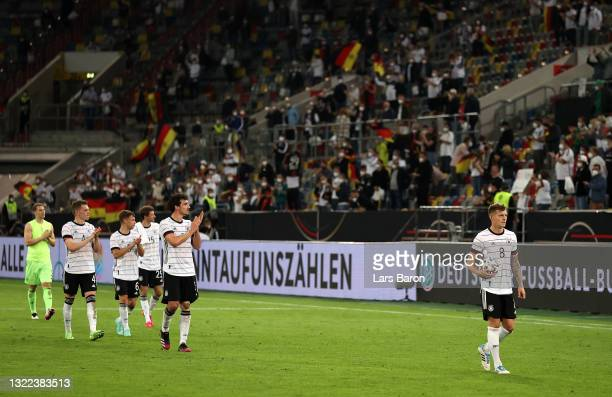 Players of Germany led by Toni Kroos interact with the crowd following the international friendly match between Germany and Latvia at Merkur...