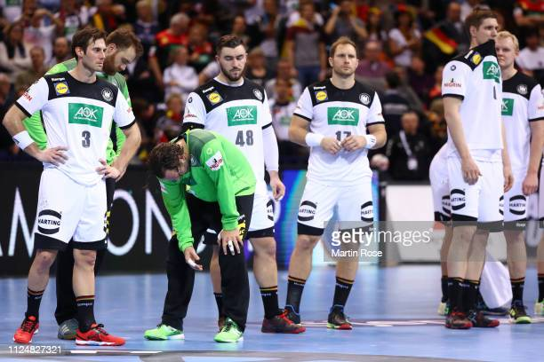Players of Germany look dejected following their side's defeat in the 26th IHF Men's World Championship semifinal between Germany and Norway at...